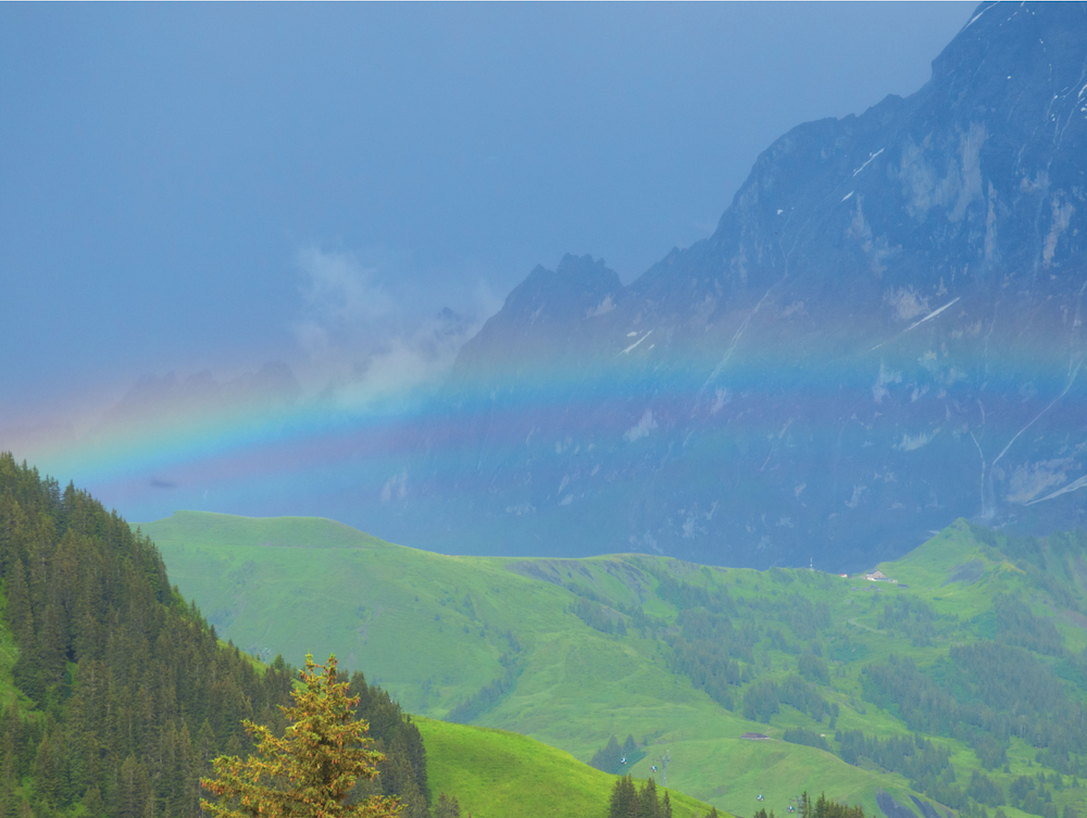 What is Color Therapy? Rainbow in front of the Wetterhorn in Grindelwald - copyright Terres Unsoeld