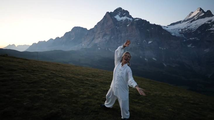 Terres Unsoeld rejoices with her Fundamental Movement at sunrise in the Swiss Alps Photo copyright Tama-Do Academy 2018