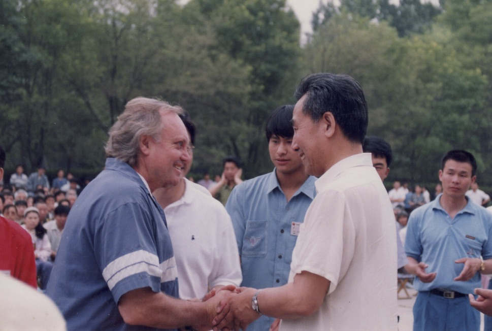 Fabien Maman is Congratulated by Master Pang Ming after being Certified as a Zhi Neng Qi Gong Instructor in 1996