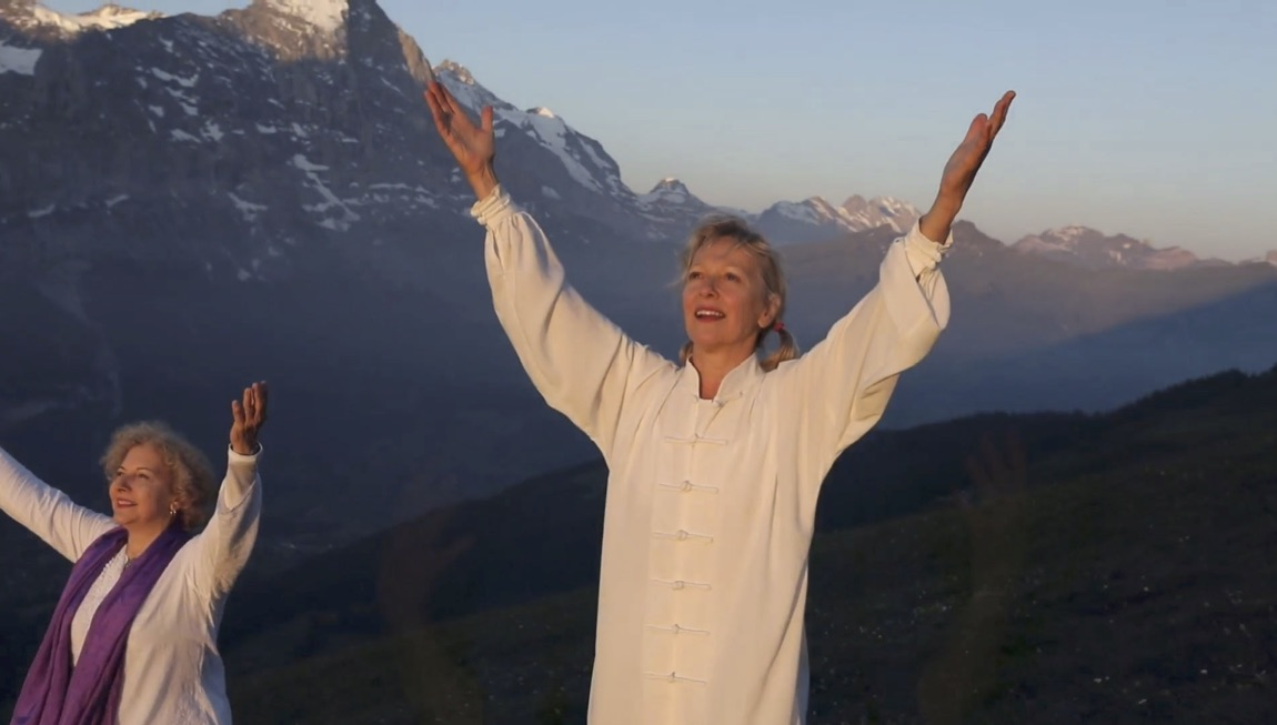 Terres Unsoeld greeting the Sun in the Swiss Alps with Josefina de Andrade by her side.